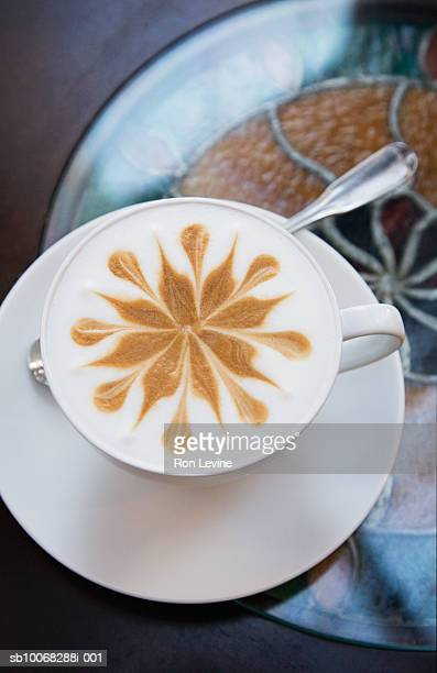 Latte with sunburst design in foam, close-up