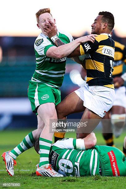 Latu Vaeno of Taranaki fends Hamish Northcott of Manawatu during the round four ITM Cup match between Manawatu and Taranaki on October 3 2015 in...