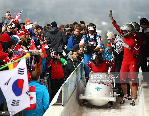 Latvia 1 wave to the fans after completing Heat 3 during the men's four man bobsleigh on day 16 of the 2010 Vancouver Winter Olympics at the Whistler...