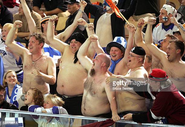 Latvia and Finland fans cheer on their teams in the third period of the IIHF World Men's Championships qualifying round game on May 9 2005 at the...