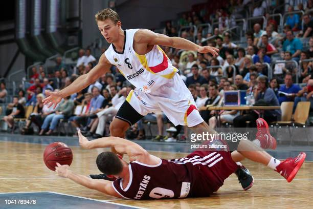 Latvia' Dairis Bertrans and Germany's Heiko Schaffartzik during in action during the basketball DBB Supercup 2014 match between Germany and Latvia at...