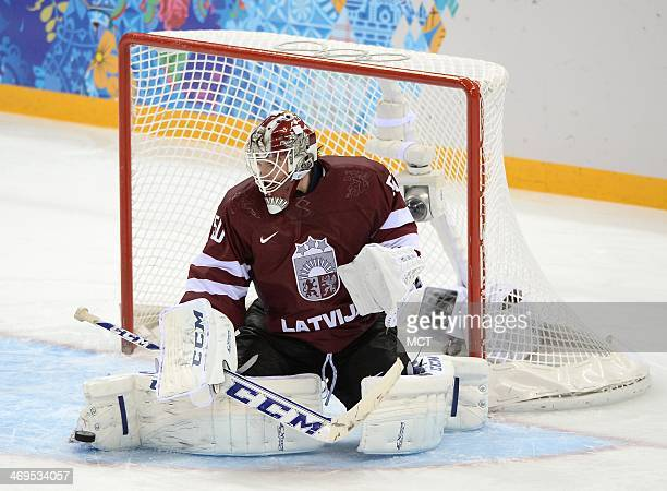 Latvia goalie Kristers Gudlevski makes a save against Sweden in the third period at Shayba Arena during Winter Olympics in Sochi Russia Saturday Feb...