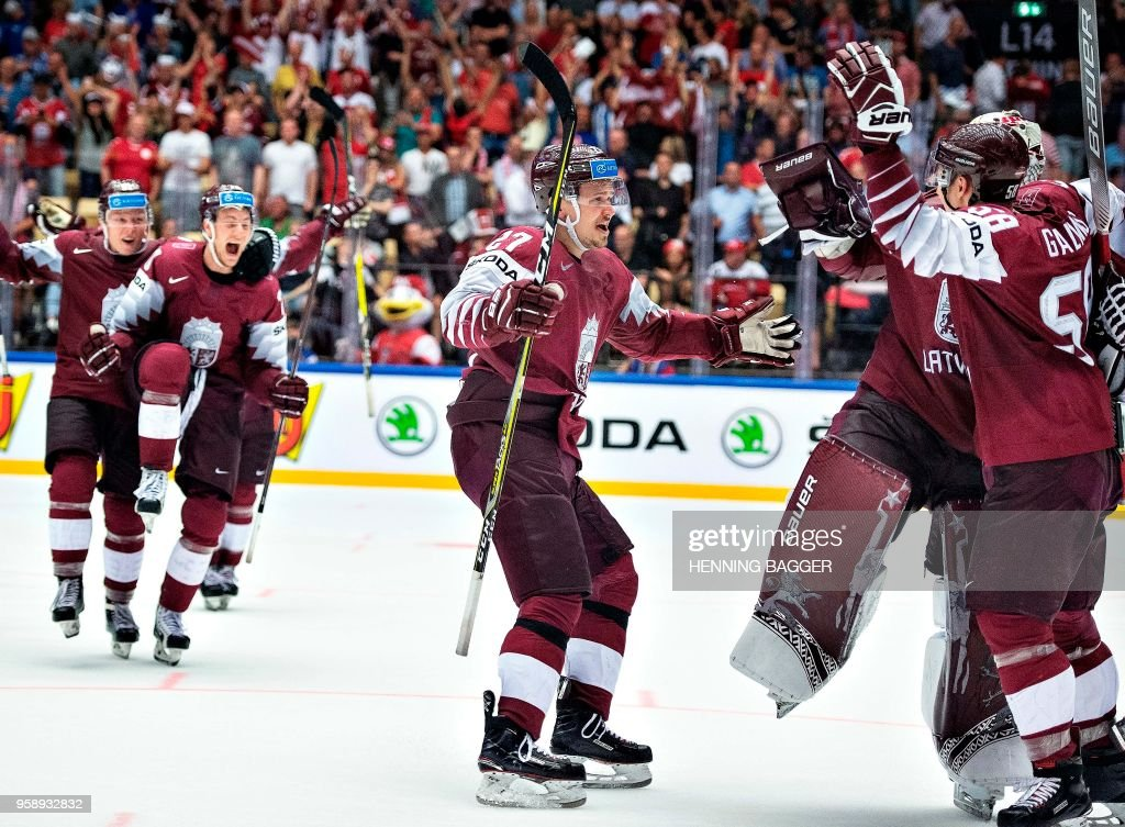 Latvia players celebrate the victory in the IIHF World Championship Group B match between Latvia and Denmark in Jyske Bank Boxen in Herning, on May 15, 2018. (Photo by Henning Bagger / Ritzau Scanpix / AFP) / Denmark OUT