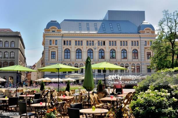 Latvia, Riga, cafe terraces on a square