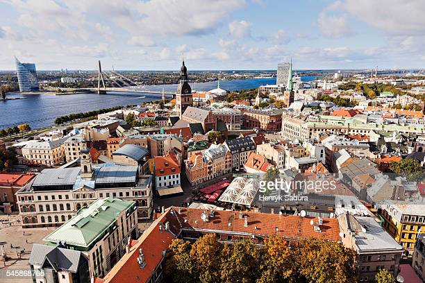 latvia, riga, cityscape of old town and river in distance - latvia stock pictures, royalty-free photos & images
