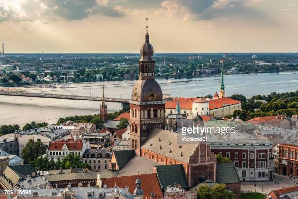 latvia, riga, cityscape with cathedral, castle and vansu bridge - ラトビア ストックフォトと画像