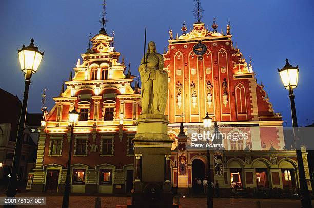 latvia, riga, house of blackheads, dusk - travel14 stock pictures, royalty-free photos & images
