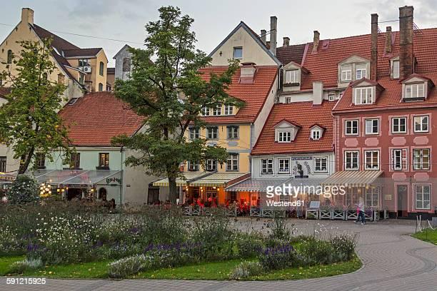 Latvia, Riga, Restaurants at Livu Square at dusk