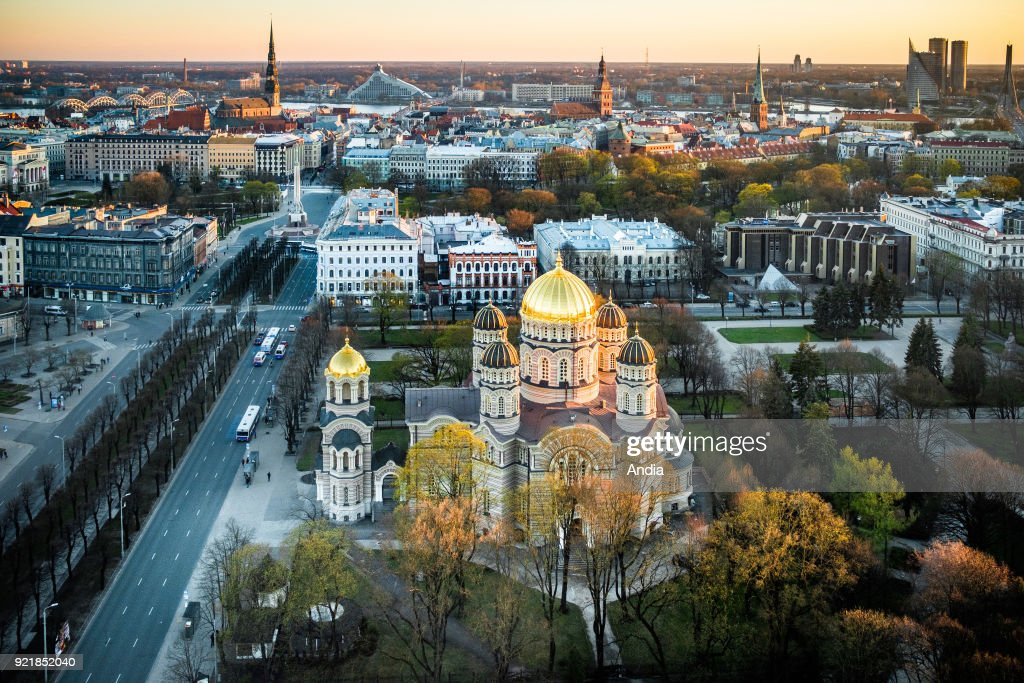 Latvia, Riga. The Nativity of Christ Cathedral built to a design by Nikolai Chagin in a Neo-Byzantine style between 1876 and 1883. Viewed from above, at sunset, from the Radisson Hotel. In the foreground, the Old City of Riga and the Daugava River.