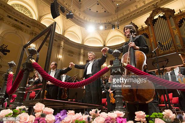 Latvian conductor Mariss Jansons acknowledges applause after his final concert with the Royal Concertgebouw Orchestra on March 20 2015 in Amsterdam...