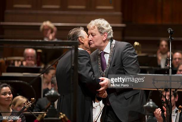 Latvian conductor receives a gift from Amsterdam Mayor Eberhard van der Laan after his final concert with the Royal Concertgebouw Orchestra on March...