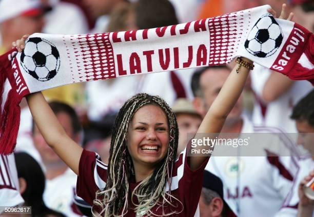 Latvian fan cheers her team during the UEFA Euro 2004 Group D match between Czech Republic and Latvia at the Estadio Municipal de Aveiro on June 15...