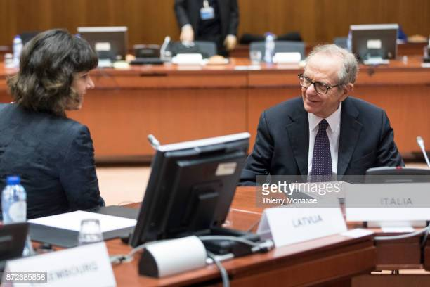 Latvian Finance Minister Dana ReiznieceOzola talks with the Italian Minister Economy Finance Pier Carlo Padoan during an EcoFin Ministers meeting in...