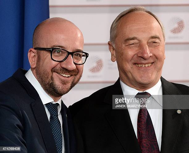 Latvian President Andris Berzins welcomes Belgium Prime Minister Charles Michel upon arrival at the House of the Blackhead for an informal dinner at...