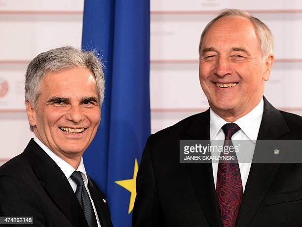 Latvian President Andris Berzins welcomes Chancellor of Austria Werner Faymann at the House of the Blackhead upon arrival for an informal dinner at...