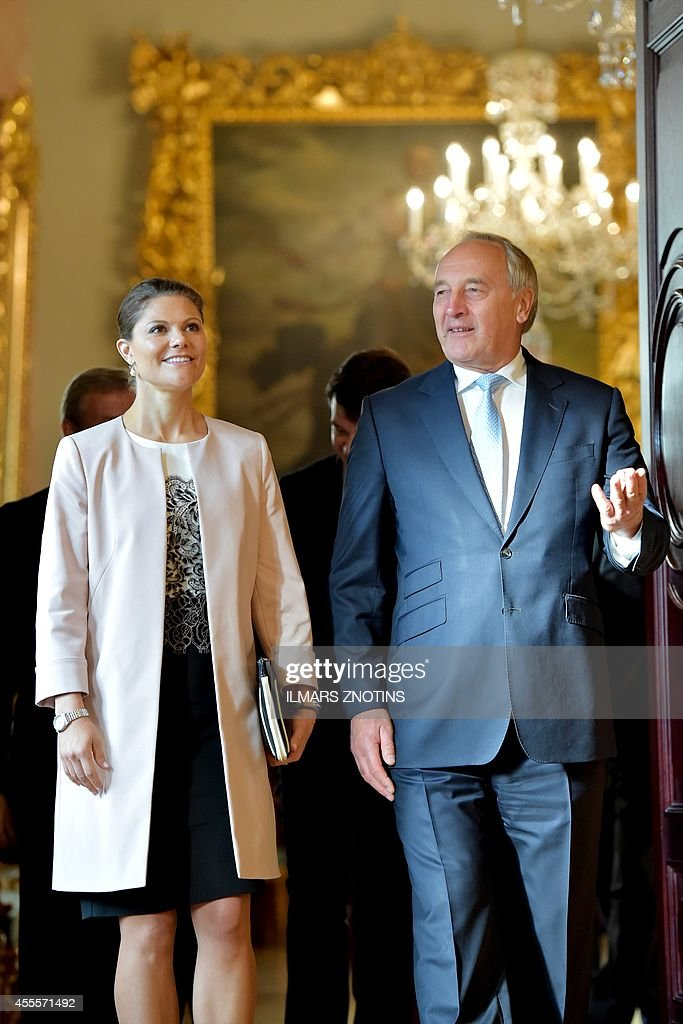 Latvian President Andris Berzins (R) welcomes Crown Princess Victoria of Sweden (L) prior their meeting in Riga, on September 17, 2014. Crown Princess Victoria of Sweden is on a working visit to Latvia. ZNOTINS