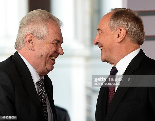 Latvian President Andris Berzins welcomes Czech Republic's President Milos Zeman upon arrival at the House of the Blackhead for an informal dinner at...