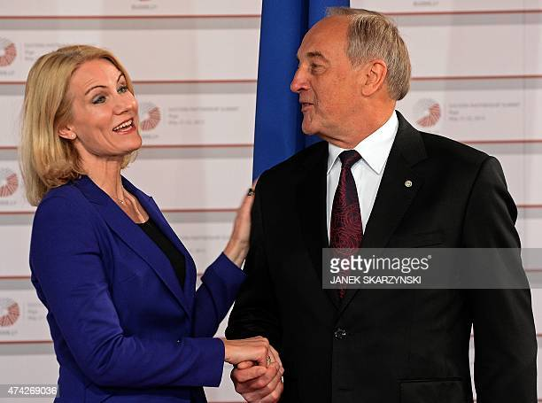 Latvian President Andris Berzins welcomes Danish Prime Minister Helle ThorningSchmidt upon arrival at the House of the Blackhead for an informal...