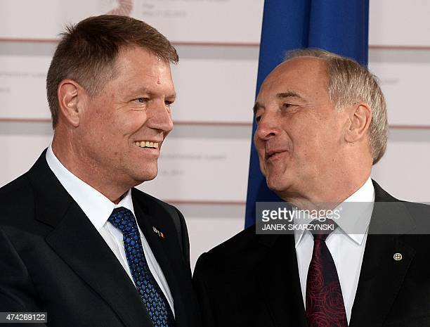 Latvian President Andris Berzins welcomes Romanian President Klaus Werner Iohannis upon arrival at the House of the Blackhead for an informal dinner...