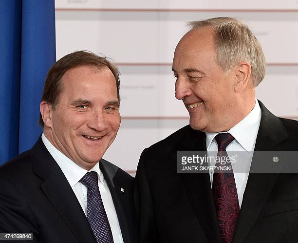 Latvian President Andris Berzins welcomes Swedish Prime Minister Stefan Loefven upon arrival at the House of the Blackhead for an informal dinner at...