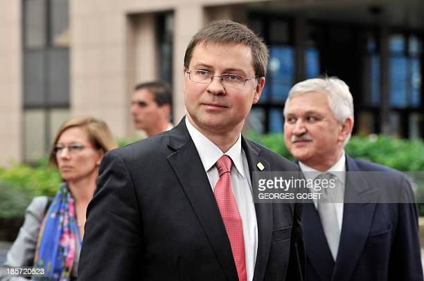 Latvian Prime Minister Valdis Dombrovskis arrives on October 24 2013 to attend a European Council meeting at the EU headquarters in Brussels European...