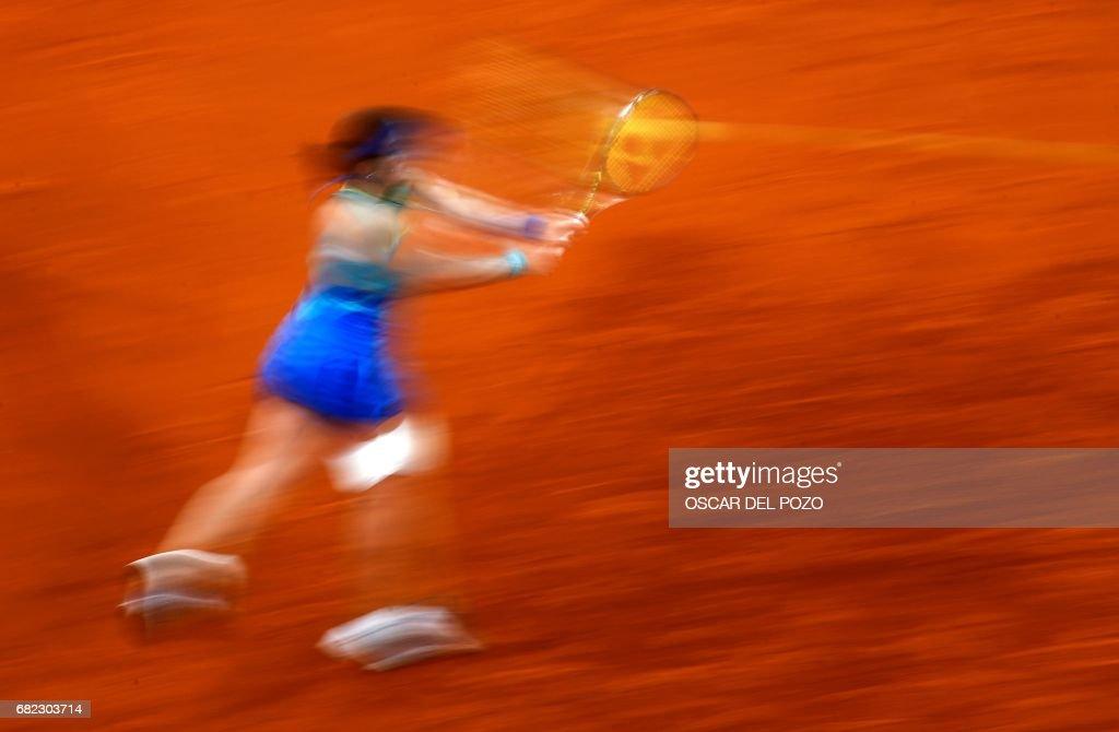 Latvian tennis player Anastasija Sevastova returns the ball to Romanian tennis player Simona Halep during the WTA Madrid Open semi final match in Madrid, on May 12, 2017. Halep won 6-2 and 6-3. /