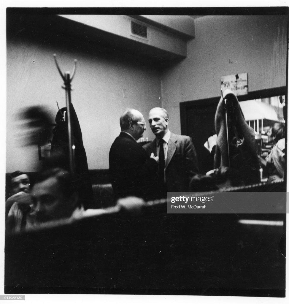 Latvian-born American painter Mark Rothko (1903 - 1970) (center left) and sculptor Peter Grippi (1912 - 2002) (center right) talk together at the Cedar Tavern, New York, New York, March 9, 1959.