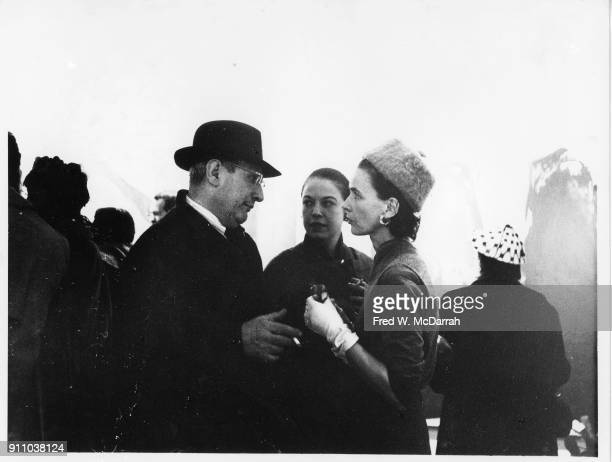 Latvianborn American painter Mark Rothko Betsy Zogbaum and an unidentified woman talk together at Sidney Janis Gallery New York New York March 9 1959