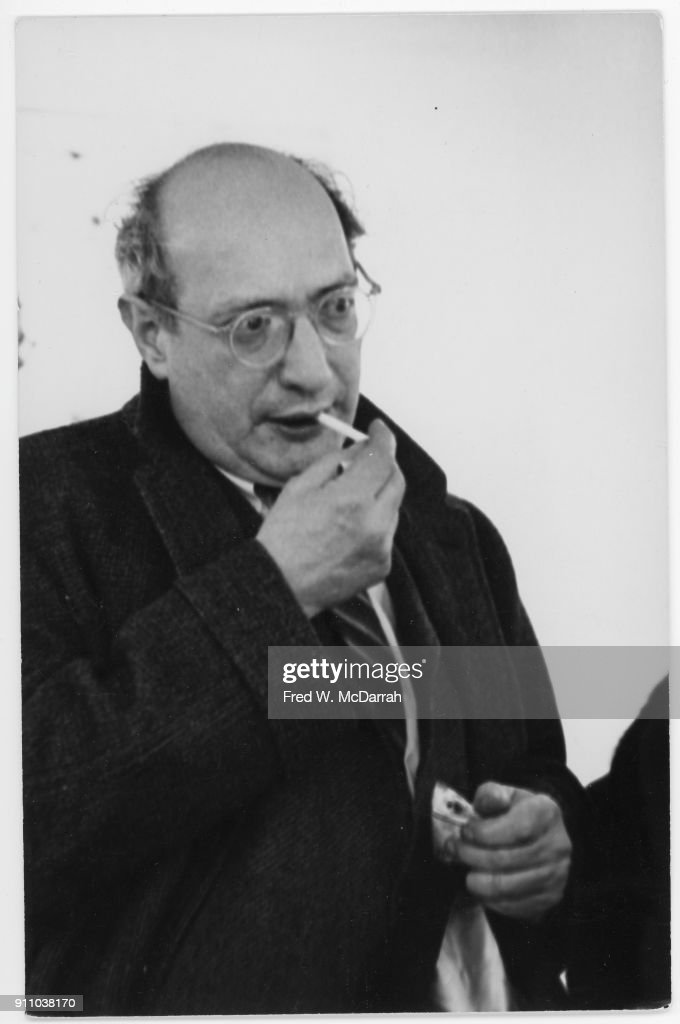 Latvian-born American painter Mark Rothko (1903 - 1970) lights a cigarette as he attends an exhibition at Sidney Janis Gallery, New York, New York, March 6, 1961.