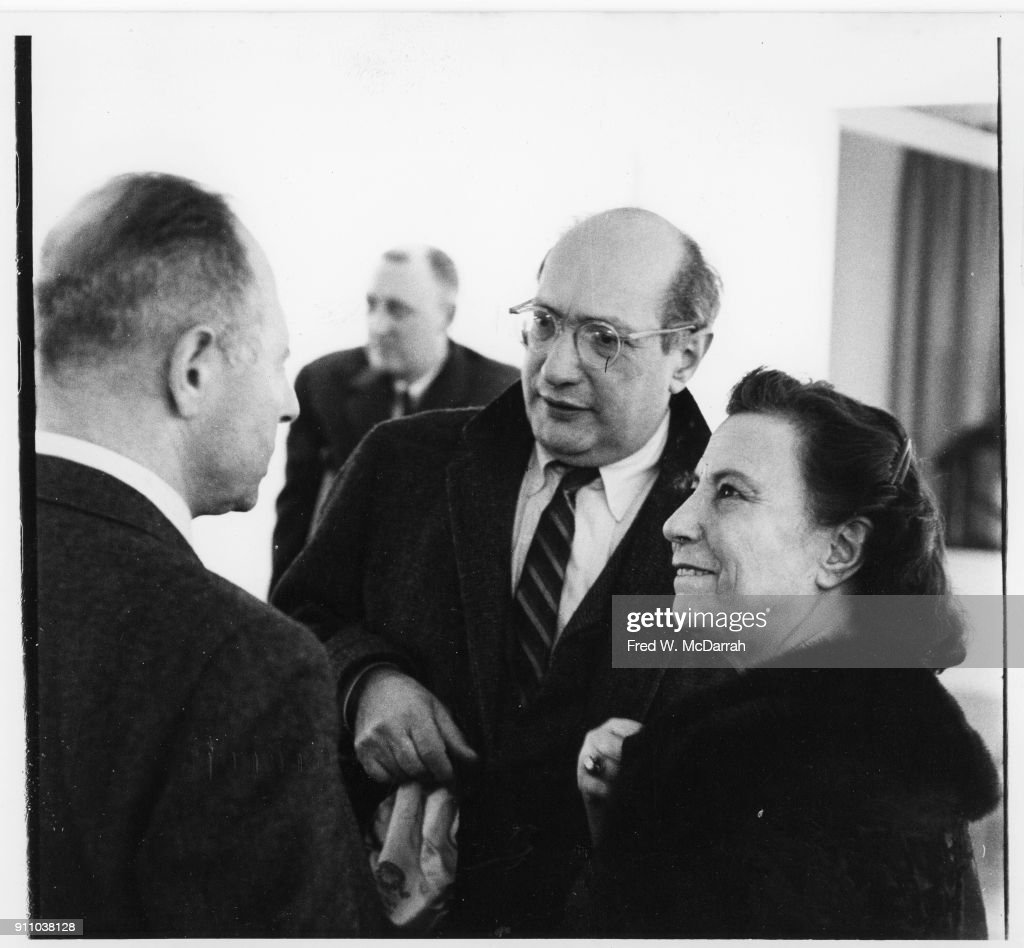 Latvian-born American painter Mark Rothko (1903 - 1970) (center) talks to unidentified others during an exhibition at Sidney Janis Gallery, New York, New York, March 6, 1961.