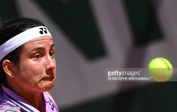 Latvia's Anastasija Sevastova eyes the ball as she returns the ball to Jennifer Brady of the US during their women's singles first round tennis match...