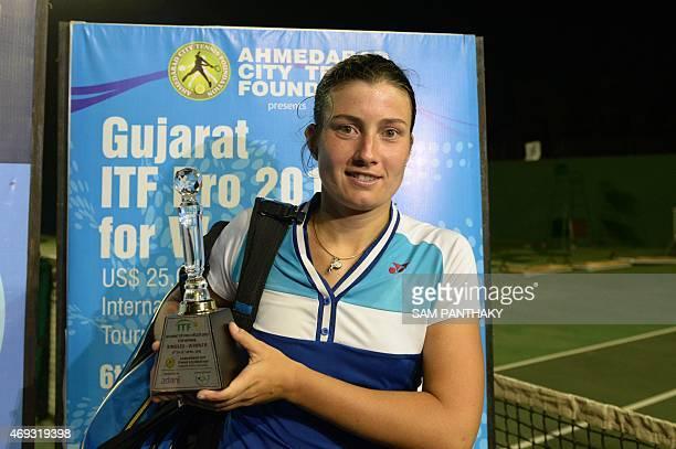 Latvia's Anastasija Sevastova hold the trophy after winning the wnining the women's singles final at the Gujarat ITF Pro 2015 tennis tournament in...