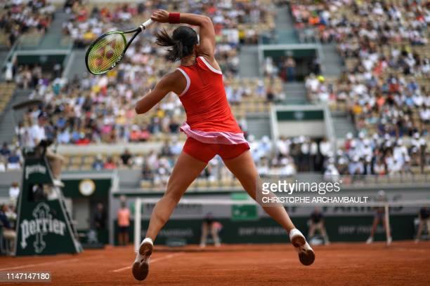 Latvia's Anastasija Sevastova returns the ball to Belgium's Elise Mertens during their women's singles third round match on day six of The Roland...