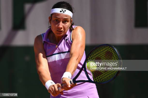 Latvia's Anastasija Sevastova returns the ball to Jennifer Brady of the US during their women's singles first round tennis match on Day 3 of The...
