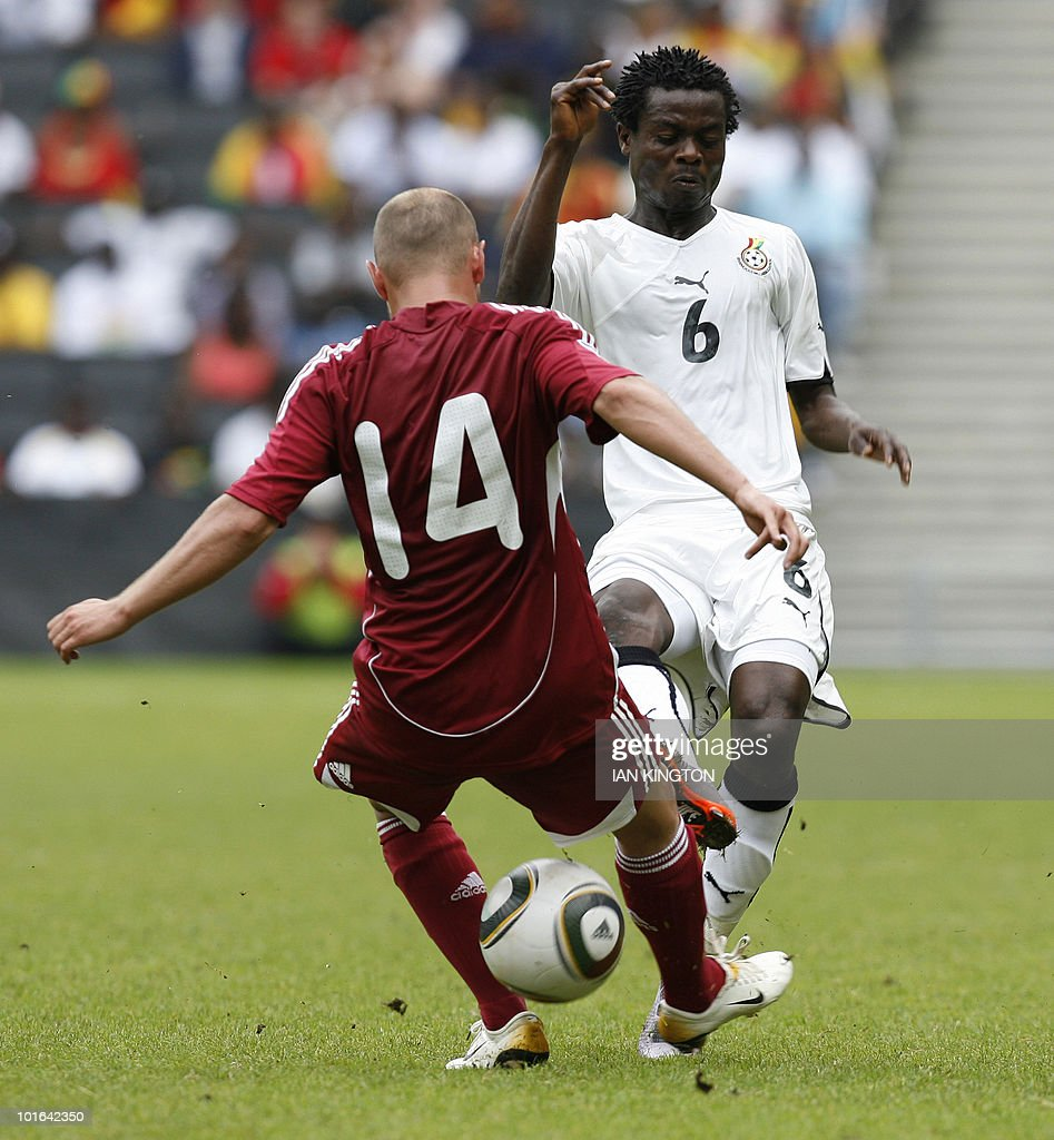 Latvia's Andrejs Pereplotkins (L) challenges Ghana's Anthony Annan during a friendly football match prior to the World Cup 2010, at the MK Stadium in Milton Keynes, on June 5, 2010.