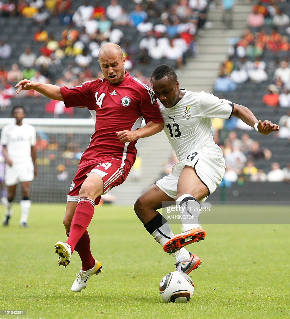 Latvia's Andrejs Pereplotkins (L) vies for the ball with Ghana's Andre Ayew during a friendly football match prior to the World Cup 2010, at the MK Stadium in Milton Keynes, on June 5, 2010.