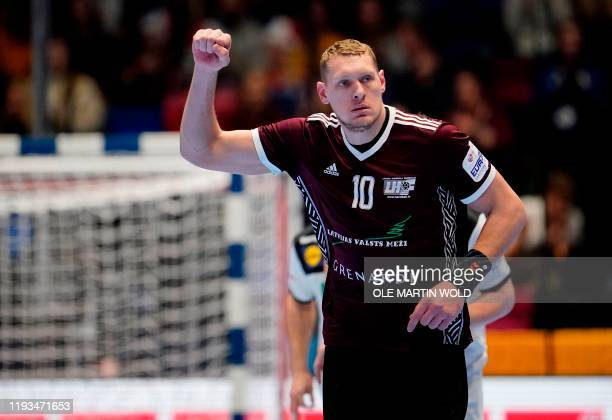 Latvia's Dainis Kristopans reacts during the men's handball European Championship Preliminary Round Group C match between Latvia and Germany in...