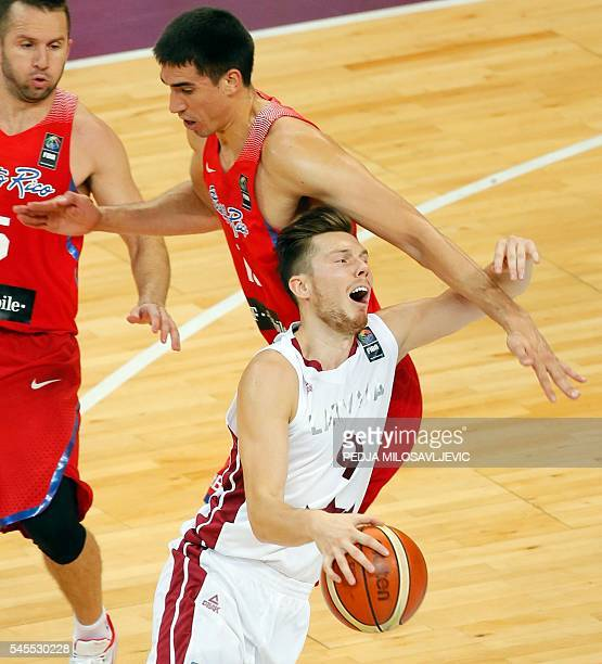 Latvia's Dairis Bertans is fouled by Puerto Rico's Ricky Sanchez Rosa during the 2016 FIBA World Olympic Qualifying semi final basketball match...