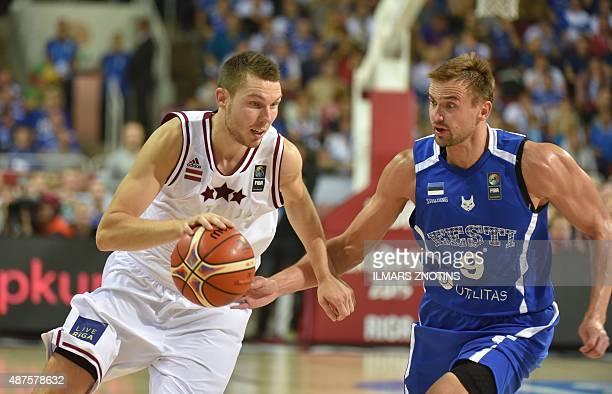 Latvia's Dairis Bertans vies for the ball with Estonia's Gregor Arbet during the Eurobasket 2015 group D basketball match Latvia vs Estonia in Riga...