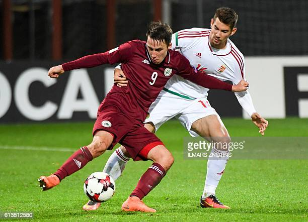 Latvia's Davis Ikaunieks vies with Hungray's Barnabas Bese during the WC 2018 football qualification match between Latvia and Hungary in Riga on...