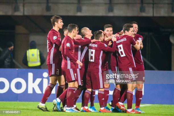 Latvia's defender Marcis Oss celebrates scoring with his teammates during the UEFA Euro 2020 Group G qualification football match Latvia v Austria in...