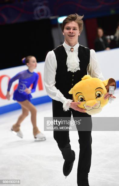 Latvia's Deniss Vasiljevs holds a championships mascot after performing his men's short program routine at the World Figure Skating Championships on...