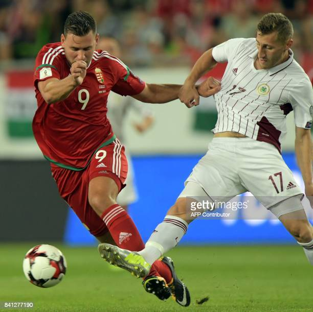 Latvia's Edgars Vardanjans vies with Hungary's Adam Szalai during the FIFA World Cup 2018 qualification football match between Hungary and Latvia in...