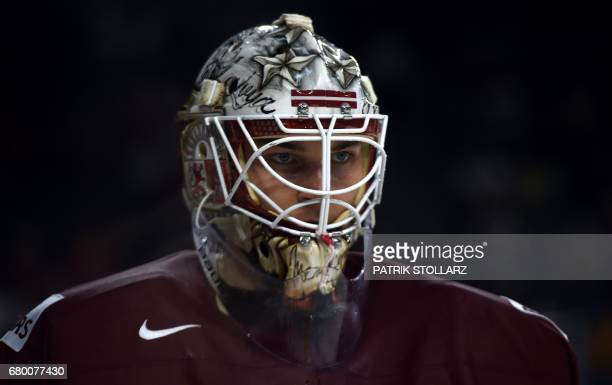 Latvia´s Elvis Merzlikins reacts during IIHF Icehockey world championship first round match between Latvia and Slovakia in the LANXESS arena in...