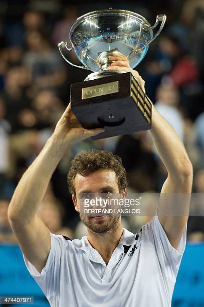 Latvia's Ernests Gulbis poses with his trophy after defeating France's Jo-Wilfried Tsonga during their Open 13 ATP tennis tournament final match on...