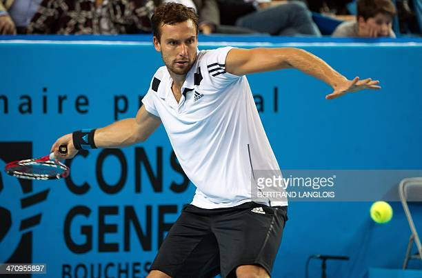 Latvia's Ernests Gulbis returns the ball to France's Nicolas Mahut during their Open 13 ATP tournament tennis match on February 21, 2014 in...