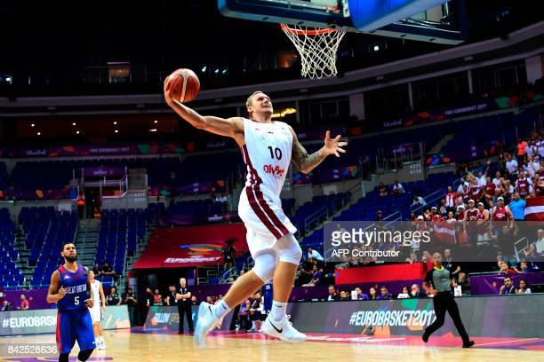 TOPSHOT Latvia's forward Janis Timma goes to basket during FIBA Eurobasket 2017 men's group D basketball match between Latvia and Great Britain at...