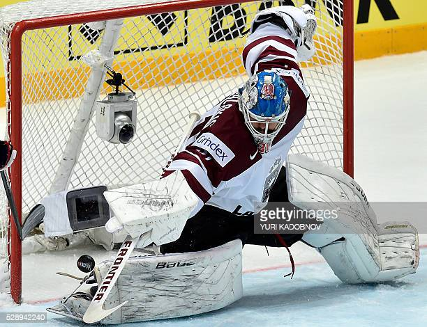 Latvia's goalie Edgars Masalskis catches a puck during the group A preliminary round game Latvia vs Czech Republic at the 2016 IIHF Ice Hockey World...