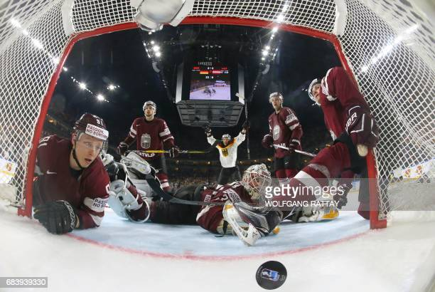 TOPSHOT Latvia's goalkeeper Elvis Merzlikins fails to save the puck during the IIHF Men's World Championship Ice Hockey match between Germany and...