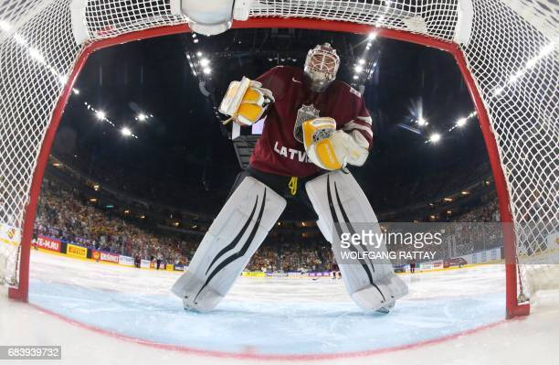 Latvia's goalkeeper Elvis Merzlikins stands in goal during the IIHF Men's World Championship Ice Hockey match between Germany and Latvia in Cologne...